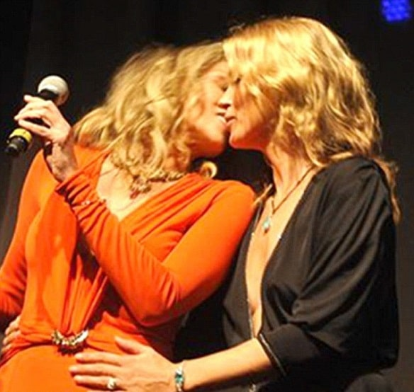 Sharon Stone and Kate Moss kiss for charity
